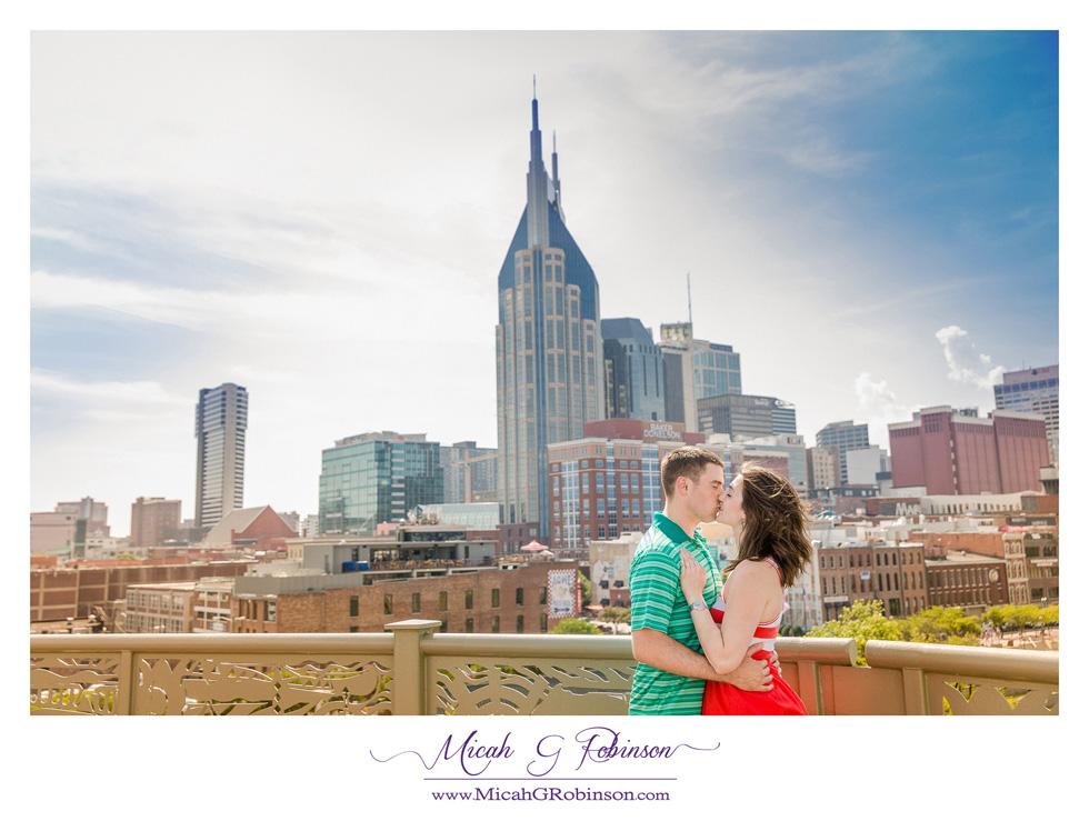 Couple engaged Nashville skyline